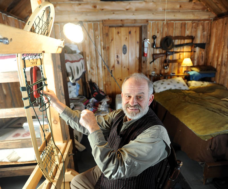 Dave Giampetruzzi, 63, of China, a 43-year veteran with the U.S. Army, fabricates a snowshoe in his cabin at Pine Grove Lodge in Bingham on Thursday. Giampetruzzi teaches snowshoe making for the Pine Grove Program, which hosts veterans and service members on select weekends for wilderness adventures. The Pine Grove Program is a nonprofit program designed to help disabled veterans and service members get outdoors for hunting, fishing and wilderness activities. The program is primarily funded through snowshoe sales.
