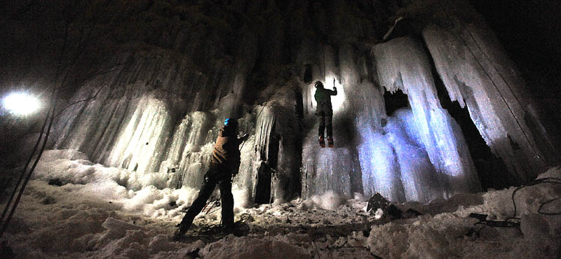 Climbers with the Colby College outing club practice their ice climbing skills at the Devil's Chair at Quarry Road Recreational Area Wednesday night.