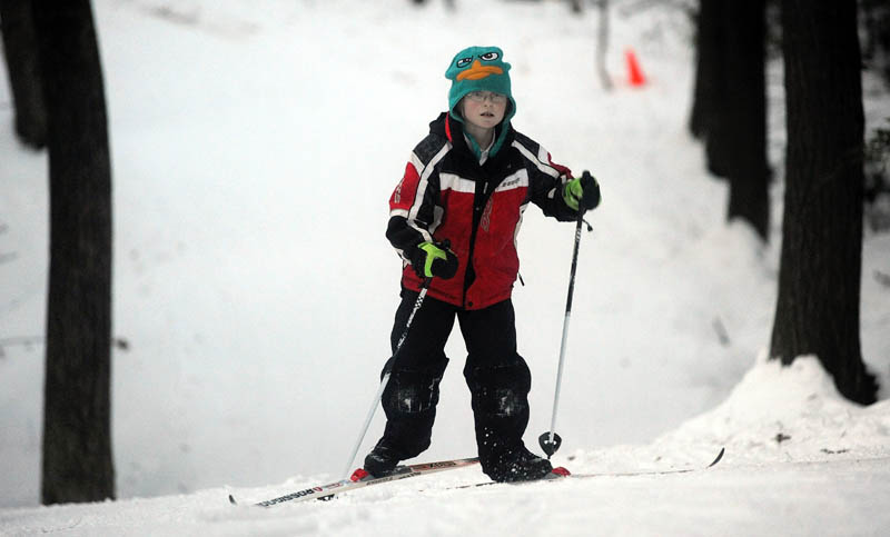 Patrick Chisum, 11, of Oakland, takes advantage of the cold temperatures and gets some laps in at the cross country ski trails at Quarry Road Recreation Area in Waterville on Friday.