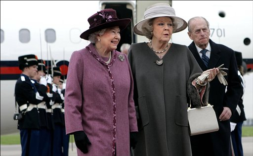 In this 2007 photo, Queen Beatrix, center, greets Britain's Queen Elizabeth II, left, and Prince Philip, right, at Rotterdam airport, Netherlands.