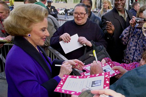 """In this 2001 photo, """"Dear Abby"""" advice columnist Pauline Friedman Phillips, known to millions of readers as Abigail van Buren, signs autographs for fans after the dedication of a """"Dear Abby"""" star on the Hollywood Walk of Fame in Los Angeles."""