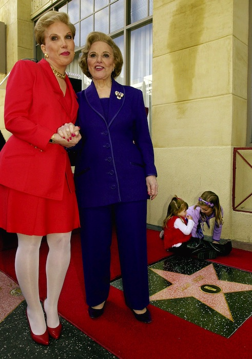 """In this Feb. 14, 2001 file photo, Pauline Friedman Phillips, right, the nationally-syndicated advice columnist best known as """"Dear Abby,"""" and her daughter Jeanne Phillips, pose after the dedication of a Dear Abby star on the Hollywood Walk of Fame in Los Angeles. Phillips, who had Alzheimer's disease, died Wednesday, Jan. 16, 2013, she was 94. Phillips' column competed for decades with the advice column of Ann Landers, written by her twin sister, Esther Friedman Lederer. Their relationship was stormy in their early adult years, but later they regained the close relationship they had growing up in Sioux City, Iowa. The two columns differed in style. Ann Landers responded to questioners with homey, detailed advice. Abby's replies were often flippant one-liners. (AP Photo/Reed Saxon)"""
