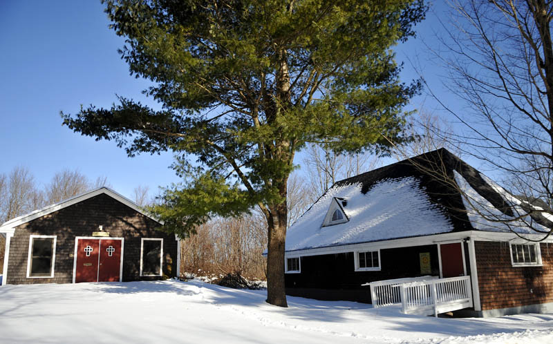 The St. Matthias Episcopal Church property and its two buildings, on a flat, half-acre lot, has been offered to the town of Richmond for free. Snow covers the lot on Monday.