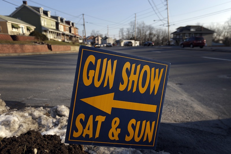 A sign is posted for an upcoming gun show, Friday, Jan. 4, 2013, in Leesport, Pa. Gun advocates aren't backing down from their insistence on the right to keep and bear arms. But heightened sensitivities and raw nerves since the Newtown, Conn. shooting are softening displays at gun shows and even leading officials and sponsors to cancel the popular exhibitions altogether. (AP Photo/Matt Rourke)