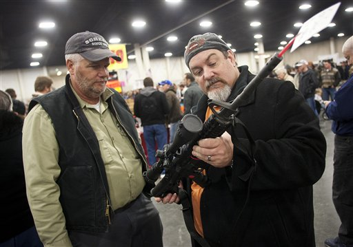 Gun owners discuss a potential sale of an AR-15, one of the most popular and controversial weapons, during the 2013 Rocky Mountain Gun Show at the South Towne Expo Center in Sandy, Utah, on Saturday. An Obama administration task force led by Vice President Joe Biden plans to offer recommendations this month on how to curb gun violence in the wake of the mass shooting at an elementary school in Newtown, Conn.