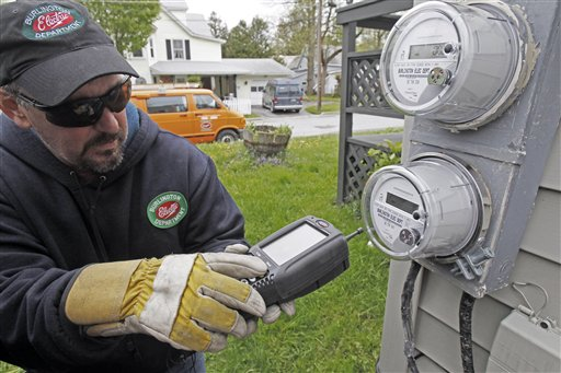 FILE- In this May 10, 2012 file photo, Mark Delbeck of Burlington Electric, checks the radio frequency of a newly-installed smart meter in Burlington, Vt. The Vermont Public Service Department has submitted its report on smart meters in Vermont to the Senate Committee on Finance and the House Committee on Commerce and Economic Development. It concluded that any potential exposure to the investigated smart meters will comply with the FCC exposure rules by a wide margin.(AP Photo/Toby Talbot)