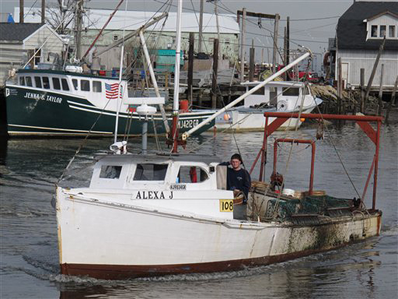 A fishing boat returns to the damaged Belford port in Middletown N.J., on Dec. 12, 2012. The port sustained nearly $1 million in damages from Superstorm Sandy, some of which its owners hope to recoup through federal storm aid.
