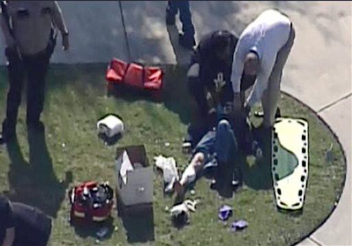 In this frame grab provided by KPRC-TV in Houston, an unidentified person is attended to by emergency personnel at Lone Star College on Tuesday.