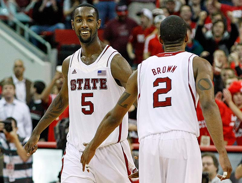 North Carolina State's C.J. Leslie, left, celebrates with Lorenzo Brown during the final minutes of Saturday's game against Duke. The Wolfpack upset the No.1 Blue Devils, 84-76.
