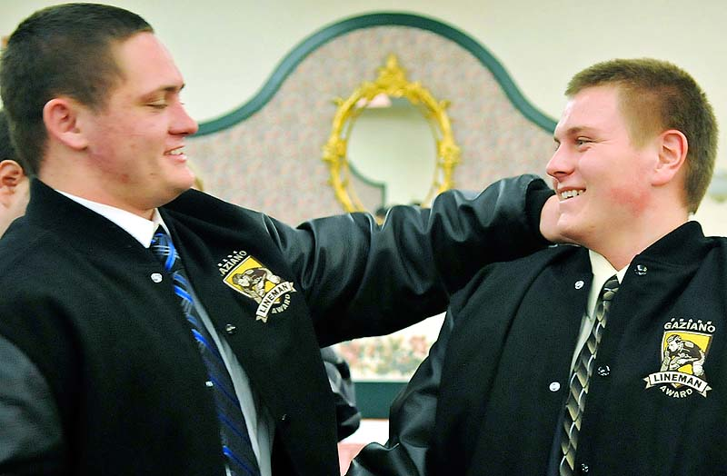 2011 Gaziano offensive lineman award winner Luke Libby, left, congratulates 2012 winner Bobby Begin Sunday during the awards ceremony in Augusta. Both played football for Thornton Academy.