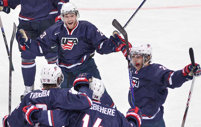 Rocco Grimaldi, top, celebrates his second goal against Sweden with teammates, from left, Jacob Trouba, Shayne Gostisbehere and Vince Trocheck during the second period Saturday in the gold-medal game at the IIHF World Junior Championships in Ufa, Russia. The U.S. won, 3-1. 2012;2013;athlete;athletes;athletic;athletics;Bronze;Canada;Cana