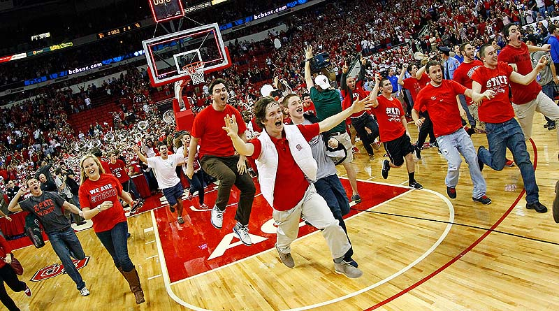 North Carolina State fans rush the court following the Wolfpack's 84-76 win over top-ranked Duke in Raleigh, N.C. Saturday.
