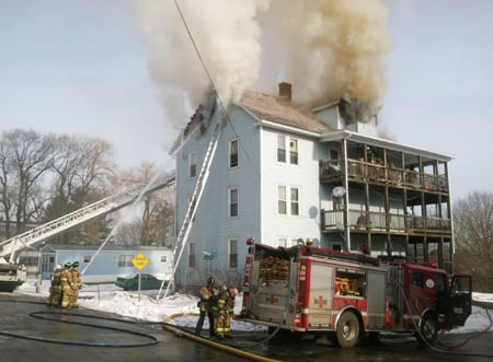 Firefighters respond to a blaze at 1 Penobscot St. in Augusta Tuesday afternoon.