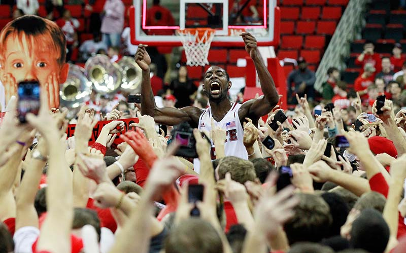 North Carolina State's C.J. Leslie celebrates with the fans after the Wolfpack's 84-76 win over top-ranked Duke in Raleigh, N.C. on Saturday.
