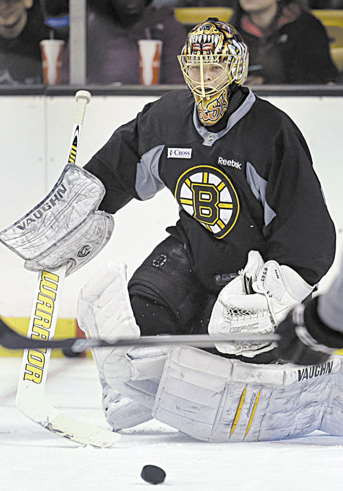 BACK AT IT: Boston goaltender Tuukka Rask keeps his eye on the puck during a practice Sunday at the TD Garden, in Boston.