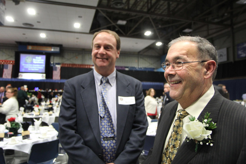 Scott Bolduc, right, President and CEO of Bolduc Technology Group, smiles with friends and colleagues prior to receiving the Business Person of the Year award at the Kennebec Valley Chamber of Commerce's annual awards banquet at the Augusta Civic Center on Friday night. Standing with Bolduc is Ted McCarthy, also of Bolduc Technology Group.