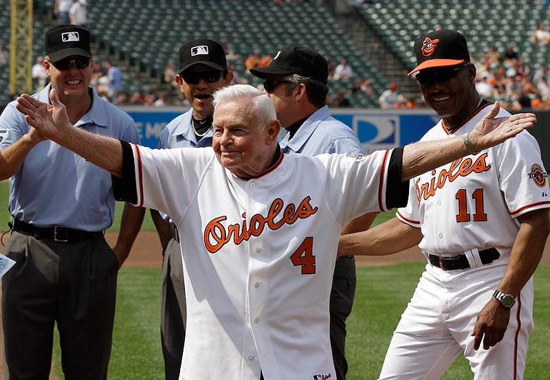 In this June 26, 2010 file photo, former Baltimore Orioles manager Earl Weaver waves to the crowd after taking the lineup card out before the start of a baseball game between the Orioles and Washington Nationals, in Baltimore, as members of the Orioles' 1970 team were honored before the start of the game. Weaver, the fiery Hall of Fame manager who won 1,480 games with the Baltimore Orioles, has died, the team announced on Saturday. He was 82.