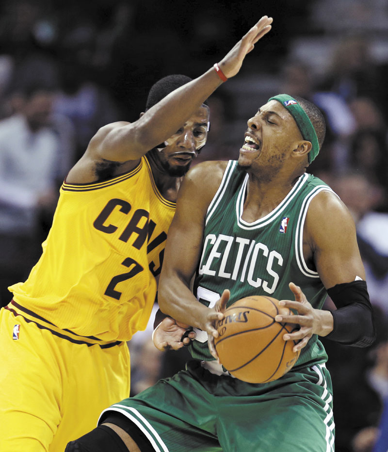 Boston Celtics' Paul Pierce, right, is stopped by Cleveland Cavaliers' Kyrie Irving during the second quarter of an NBA basketball game, Tuesday, Jan. 22, 2013, in Cleveland. (AP Photo/Tony Dejak) Quicken Loans Arena