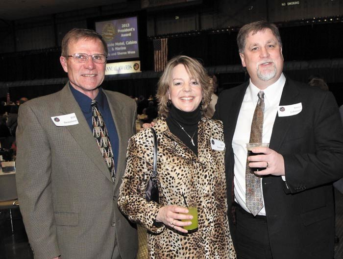 From left, representing Kozak and Gayer are Bill and Jane Dennison, and Steven Johnson, at the Kennebec Valley Chamber of Commerce's annual awards banquet at the Augusta Civic Center on Friday night.