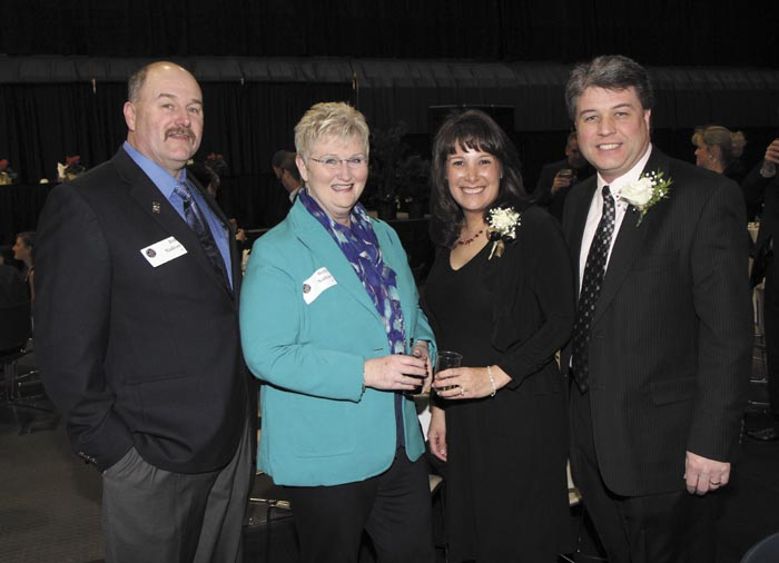 From left, Bob and Becky Nadeau with President's Award recipients Teresa and Randy Hutchins, of O'Connor Auto Group, at the Kennebec Valley Chamber of Commerce's annual awards banquet at the Augusta Civic Center on Friday night.