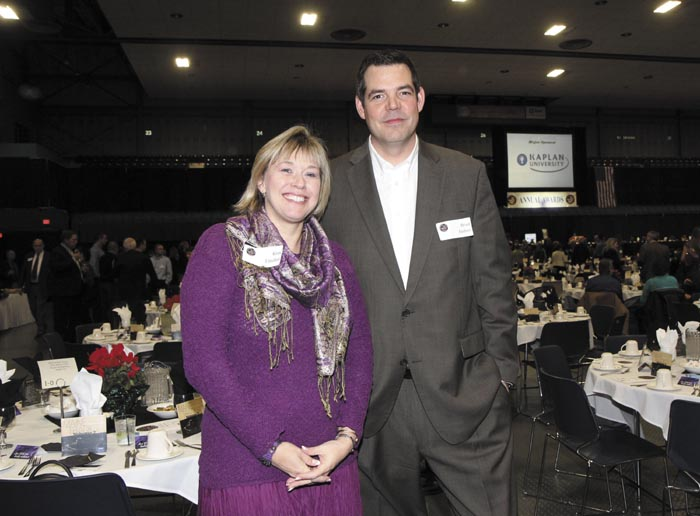 Kimberly Lindlof, of the Mid-Maine Chamber of Commerce, and Brad Frishe,r of New Dimensions Federal Credit Union, at the Kennebec Valley Chamber of Commerce's annual awards banquet at the Augusta Civic Center on Friday night.