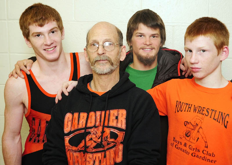 FAMILY PORTRAIT: Richard Del Gallo, center, is the father to sons Dan, left, Matt, back and Peter, a family that has enjoyed wrestlling success at Gardiner Area High School. Matt holds the record with 171 wins, a mark both Dan and Peter should challenge.