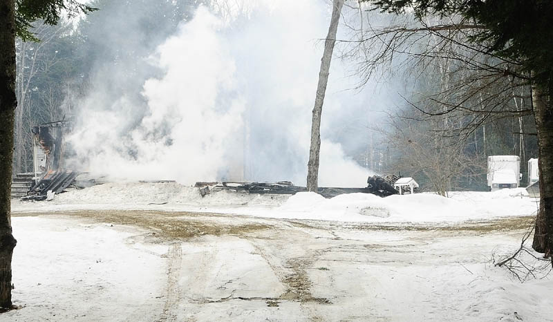 This home at 57 Poplar Point was still steaming at 1:01 p.m. on Friday, after it was destroyed by an overnight fire in Mount Vernon.