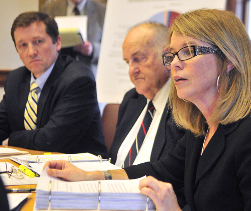 Education Commissioner Steve Bowen, left, Sawin Millett, commissioner of administrative and financial services, listen as Department of Health and Human Services Commissioner Mary Mayhew speaks during a news conference on Friday in the Cabinet Room of the State House in Augusta.
