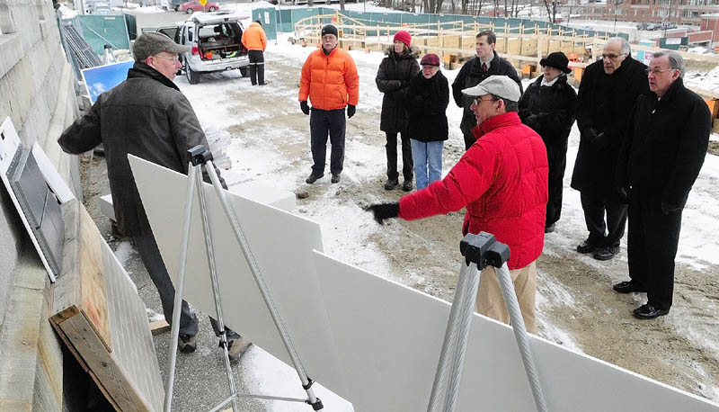 Alan Kuniholm, left, and Peter Anderson, of PDT Architects, talk about the color of the exterior building materials during a site visit by the Augusta Planning Board Tuesday, between the old and new Kennebec County Superior Court houses.