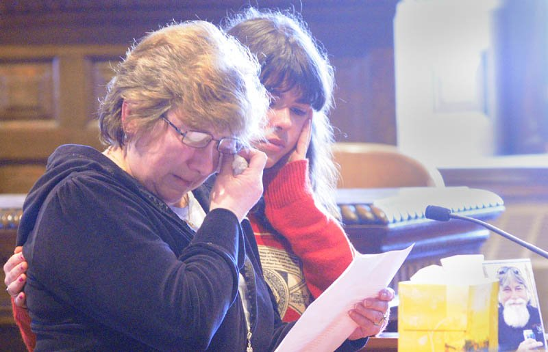 Janet Orr, left, is comforted by family friend Jodi Ferry as she speaks on Friday in Kennebec County Superior Courthouse in Augusta, during the sentencing of David Silva, who pleaded guilty of murdering her husband, Robert Orr, and burning down their Readfield home.