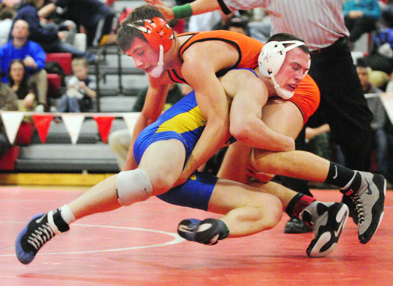 Skowhegan's Kameron Doucette, top left, and Belfast's Brent Waterman grapple in the 132-pound championship match during the KVAC wrestling championship on Saturday at Cony High School in Augusta. Waterman won 16-1.