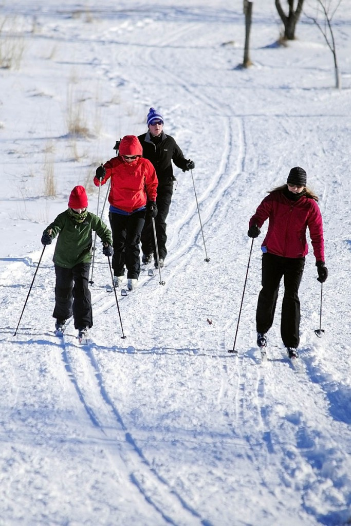 Cross country skiers curve around a bend in the trail on Tuesday at the Viles Arboretum in Augusta. There are several miles of groomed ski trails at the arboretum, which is located at 153 Hospital St.
