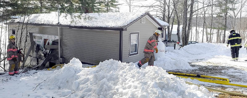 After knocking down the fire earlier, firefighters continuing work Tuesday morning at 769 Plains Rd. in Litchfield.