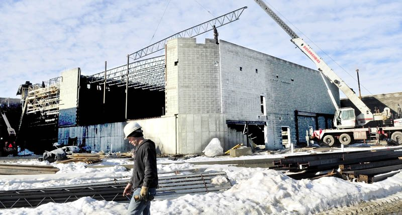 Construction workers with the Wright-Ryan Construction, erect the Bjorn Auditorium at Mt. Blue High School Learning Campus in Farmington recently.