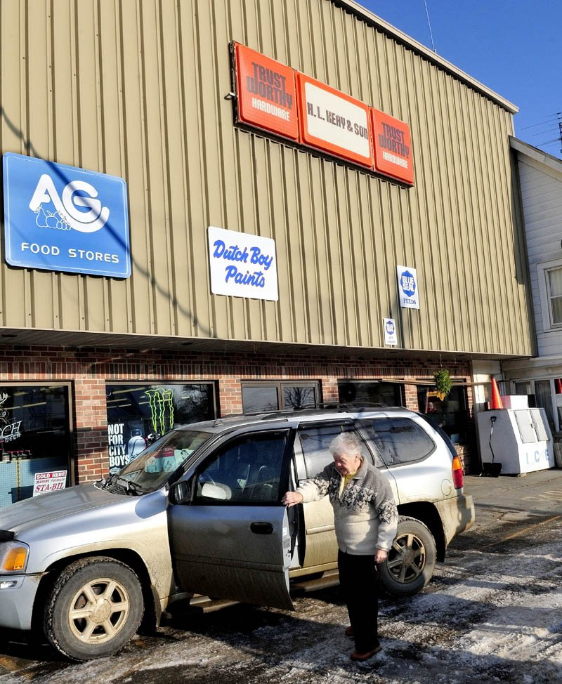 """Albion resident Charlene Quimby gets out of a vehicle at the H.L. Keay & Son store in Albion on Wednesday. The store is closing, probably this week, after 86 years in business. """"It's a tragedy they are closing,"""" Quimby said. """"Harold and his son Crosby were so generous to the community."""" She added that shoppers could always get what they wanted without driving to bigger stores."""