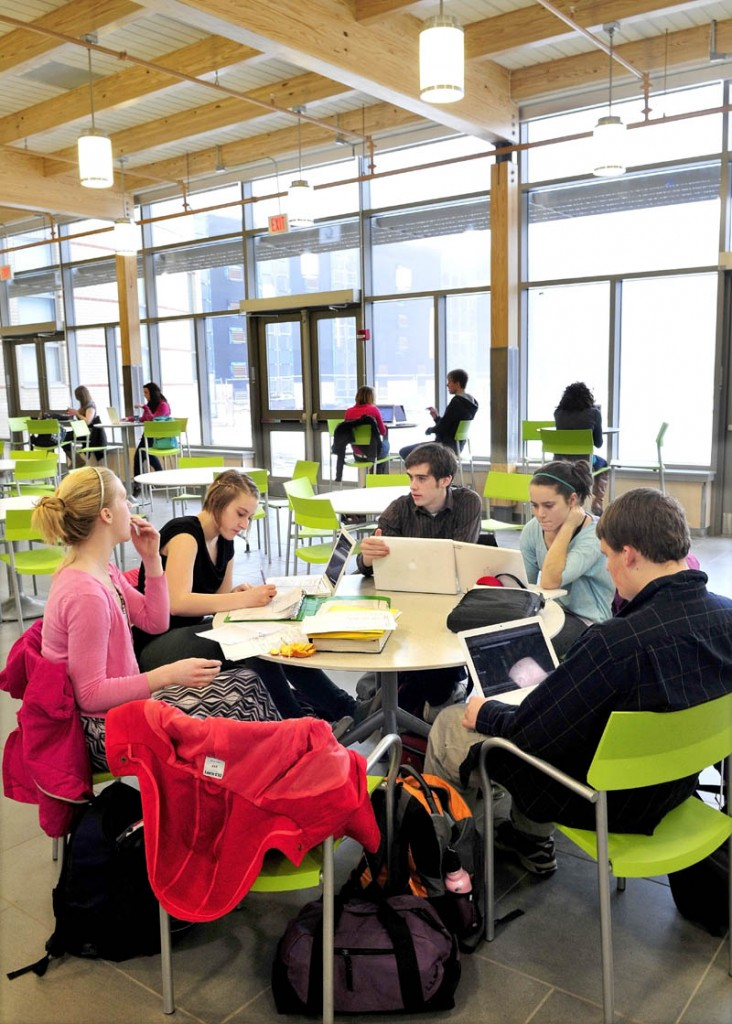 Students do schoolwork in the bright and spacious Food Court area in the new expansion project at Mt. Blue High School Learning Campus in Farmington recently.