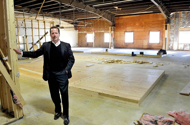 Bill Mitchell stands inside a section of Penney Hill Park on Kennedy Memorial Drive in Waterville, where six retail units will soon be available, on Wednesday. Goodwill Industries of Northern New England occupies another level of the building.
