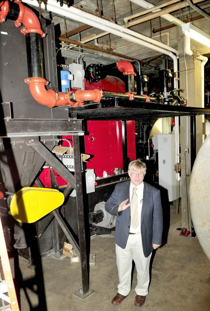 SAD 54 Superintendent Brent Colbry speaks in front of the new wood pellet boiler system inside Skowhegan Area High School on Thursday. Colbry said the efficient system could be paid for in fuel savings over the next 10 years.