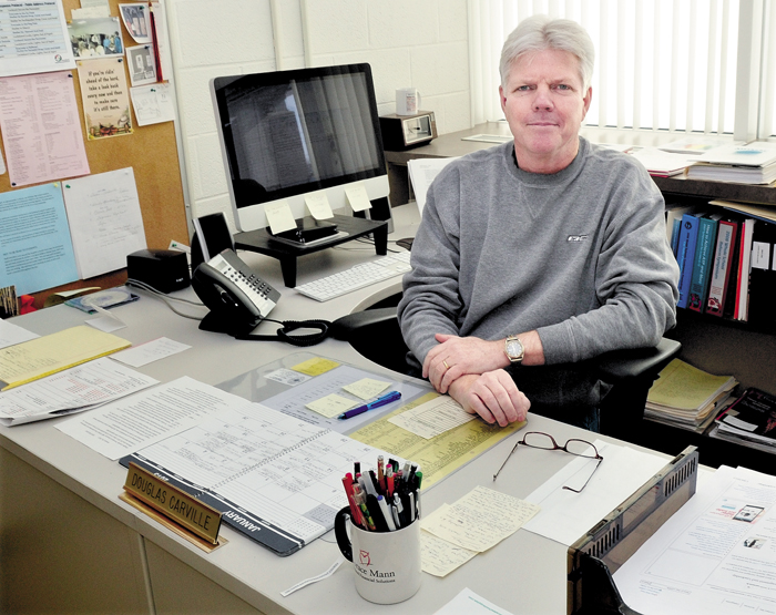 Winslow High School Principal Doug Carville in his office on Monday. Carville will leave his position at the end of the school year to pursue other employment.