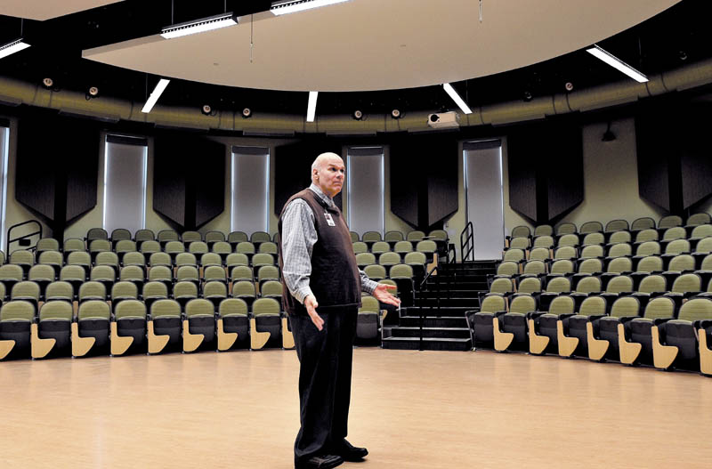 Regional School Unit 9 Superintendent Michael Cormier shows off the Forum room in the Mt. Blue High School Learning Campus expansion project in Farmington recently.
