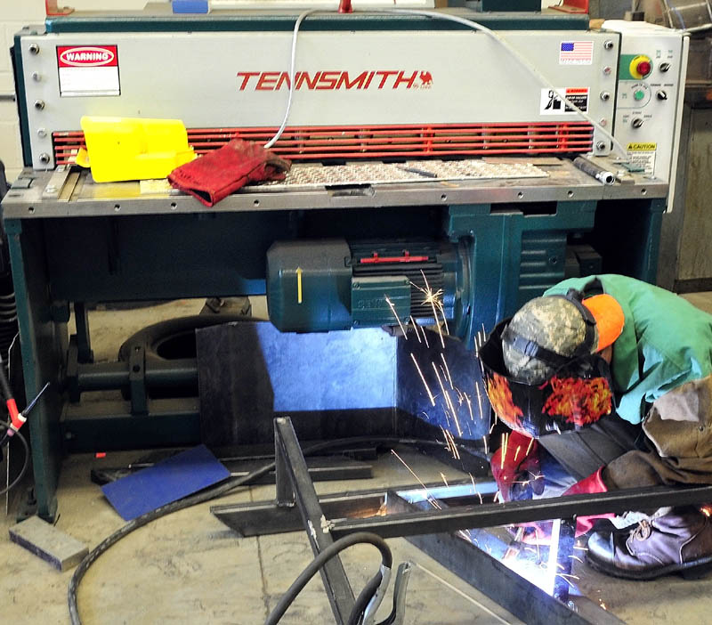 Mt. Blue High School student Randon Ireland does some welding in front of some new equipment that is part of the expansion project at the Farmington school recently.