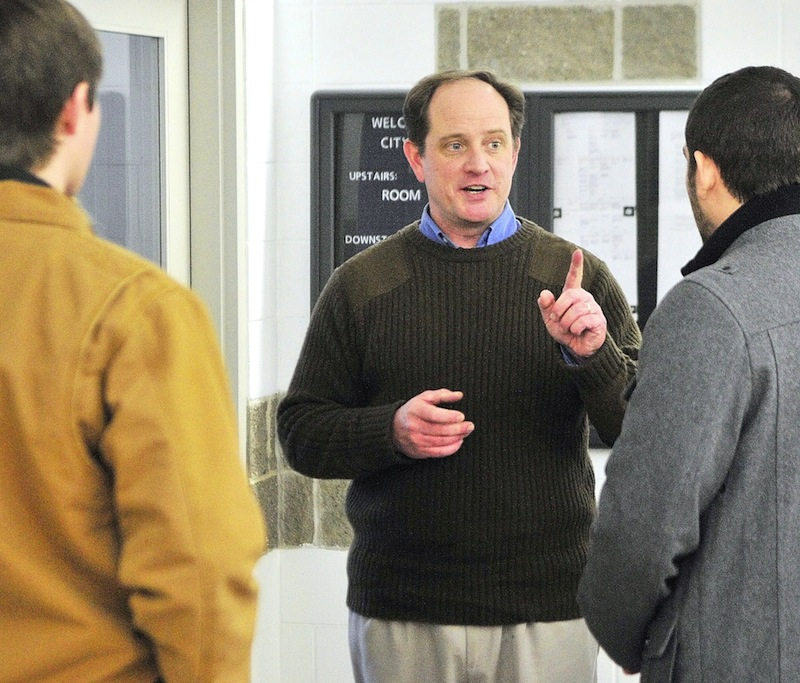 Mark Willis, Republican National Committeeman for Maine, talks to fellow party members on Saturday Jan. 12, 2013 after a state committee meeting in Augusta City Center.