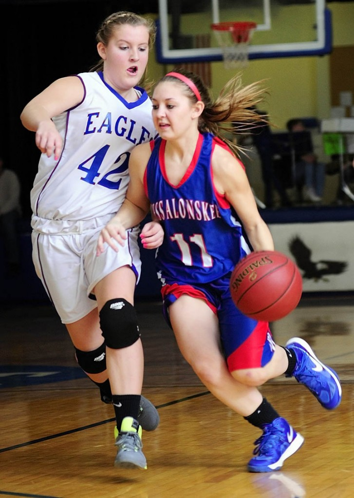 Erskine's Mallory Chamberlain, left, tries to stop Messalonskee's Nicole Collier during a game on Friday in the James V. Nelson Gym at Erskine Academy.