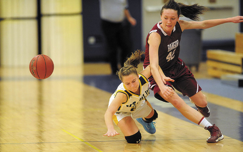 MAKING AN EFFORT: Mt. Blue High School's Mackenzie Conlogue, left, battles for the loose ball with Bangor High School's Mary Butler in the second quarter of the Cougars' 49-42 win Thursday in Farmington.
