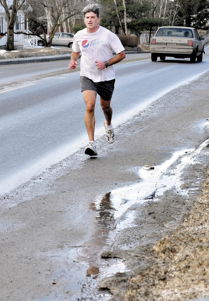 Steve Tosi took advantage of an unseasonably warm Monday, while running in Waterville.