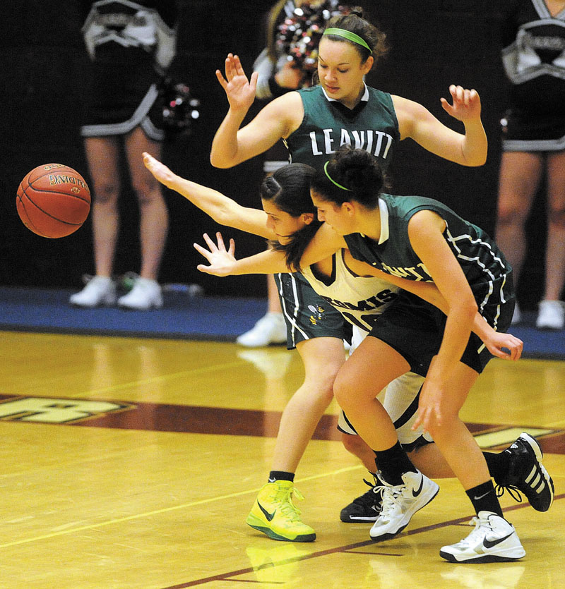 Nokomis High School's Lacey Kent-Webber, 10, battles for the loose ball with Leavitt High School's Meagan Dow, 5, foreground and Sierra Santomango, 23, background in the fourth quarter in Newport Thursday.