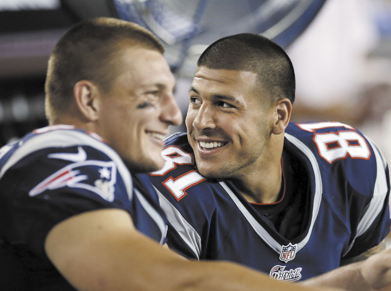 DYNAMIC DUO: New England Patriots tight ends Aaron Hernandez, right, and Rob Gronkowski, left, have played just five games together this season because of injuries. Now the Patriots dangerous tight ends are back and posing a major threat to the Houston Texans in Sunday's AFC divisional playoff game. Emotion Night