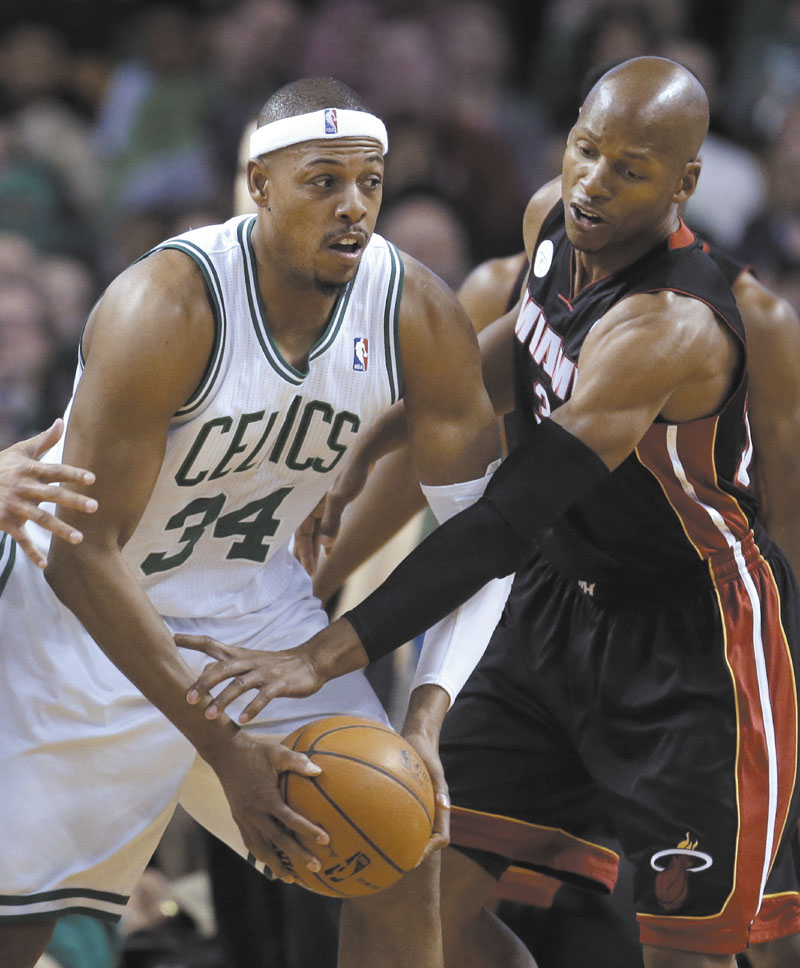 EXTRA DUTIES: Boston Celtics forward Paul Pierce, left, will likely take on more ball handling duties now that point guard Rajon Rondo is out for the season with a torn ACL.