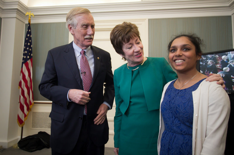 Maine Sen. Susan Collins pays a visit to Sen. Angus King and his daughter, Molly, during a reception after King's swearing-in Thursday.