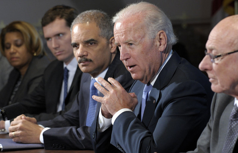 Vice President Joe Biden, with Attorney General Eric Holder, speaks at a meeting with victim's groups and gun safety organizations at the White House complex on Wednesday.